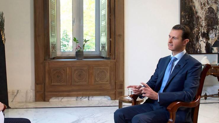 Der syrische Machthaber Baschar al-Assad im Interview mit einem Reporter des italienischen Fernsehens RAI.