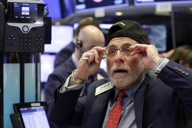 Ungläubige Gesichter an der Wall Street: Der Dow Jones stürzte am Montag um 1100 Punkte ab und verzeichnete den schlimmsten Verlust seit sechseinhalb Jahren.