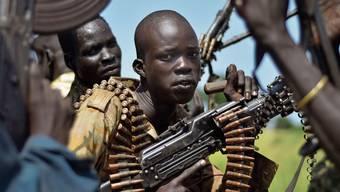 Afrikaner an den Waffen: Noch immer sterben in den Kriegen des Kontinents jedes Jahr Zehntausende Menschen.