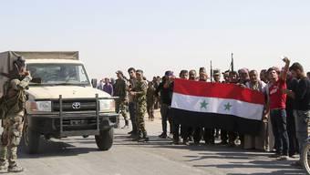 Syrische Regierungstruppen werden im Norden des Landes als Verteidiger gegen die türkische Armee gefeiert.