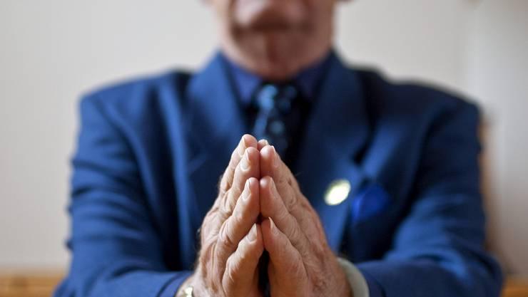 Die Mitglieder der Freikirche beten in den ehemaligen Räumen einer Plattenfirma. (Symbolbild)