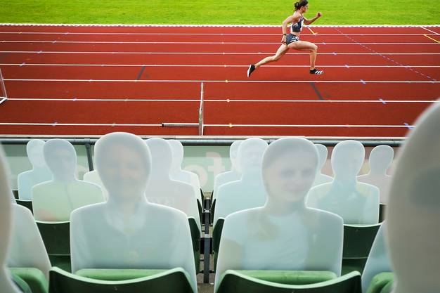 epa08479902 Cardboard cut-outs in the stands as Lea Sprunger of Switzerland competes in the women's 300m Hurdles race during the Diamond League Impossible Games athletics exhibition at Bislett Stadium in Oslo, Norway, 11 June 2020.  EPA/HEIKO JUNGE  NORWAY OUT