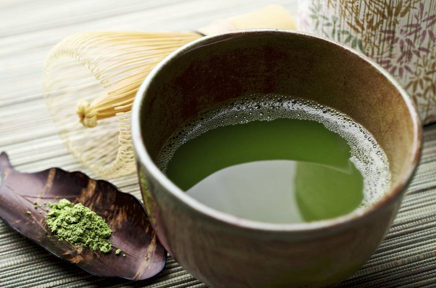 «SEVERAL MORE IN THIS SERIES. Freshly whisked powdered green tea (matcha) with cherrywood scoop, bamboo whisk and tea canister.  Very shallow DOF.»
