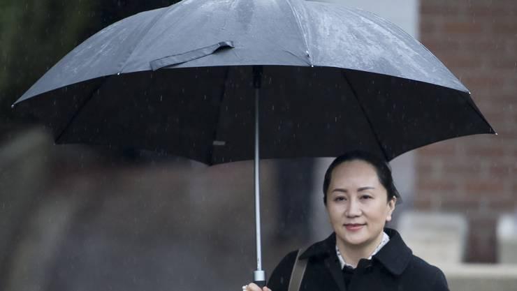 Huawei-Finanzchefin Meng Wanzhou unterwegs zur Anhörung an einem Gericht in Vancouver. Ob Kanada sie an die USA ausliefert, ist noch offen.