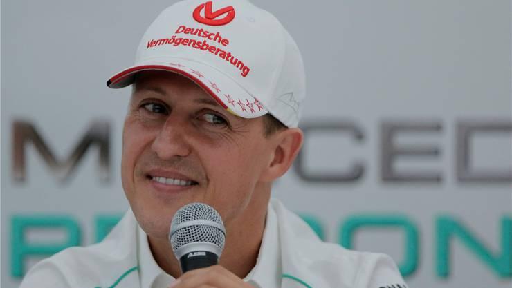 Michael Schumacher bei einer Pressekonferenz im Jahr 2012. Fotos: Keystone