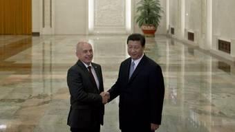 Ueli Maurer (l.) und Chinas Staatschef Xi Jinping (Archiv)