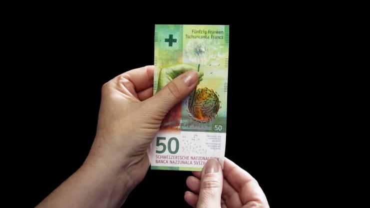 Die Hand, sowie die grosse Zahl 50 und der Schriftzug der Nationalbank heben sich tastbar ab.