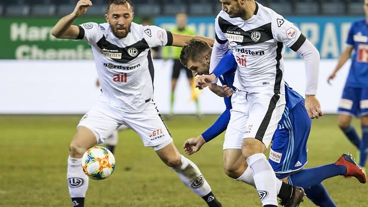 Luganos Mijat Maric (links) wird im Cup gegen Thun gesperrt fehlen, während sein Teamkollege Miroslav Covilo (rechts) noch auf aufschiebende Wirkung seiner Sperre hoffen darf