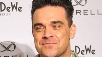 Das Windelnwechseln hats Robbie Williams angetan (Archiv)