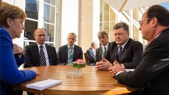 Angela Merkel, Wladimir Putin, Petro Poroschenko und François Hollande während Gesprächen in Paris.Mikhail Palinchak/ap/keystone