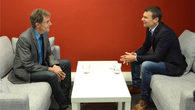 Streiten engagiert, aber gut gelaunt über den Verkehr in der Agglomeration: Die beiden Landräte Martin Rüegg (SP, links) und Christof Hiltmann (FDP).
