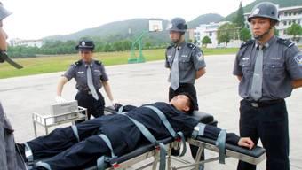 Ein Verurteilter wartet auf die Giftspritze: In China gilt für schwere Verbrechen die Todesstrafe. (Symbolbild)