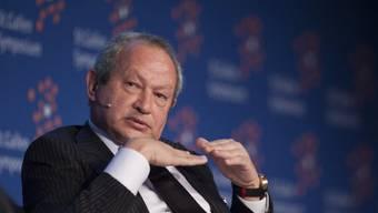Der ägyptische Milliardär Naguib Sawiris - hier 2013 am 43. St. Gallen Symposium - möchte Gutes tun für Flüchtlinge, aber keiner lässt ihn (Archiv).