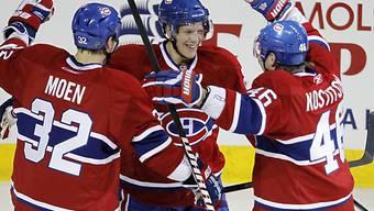 Montreals Lars Eller (Mitte) bejubelt sein zweites Tor gegen Boston