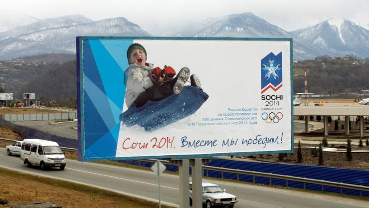 Cars ride by a billboard appealing to bring the 2014 Winter Olympics to Russia in the outskirts of the Black Sea resort city of Sochi, Russia, in this Mon. Jan. 22, 2007 photo. The billboard reads: Sochi 2014, Together we shall win! With its palm trees and Black Sea beaches, Sochi seems like a good spot to hold the Summer Olympics. Turn your back on the seaside sights, though, and it's clear why the city is bidding for the 2014 Winter Games. The dramatic setting combining subtropical vegetation and alpine chill in a comparatively compact area is a key element in Sochi's campaign to bring the Winter Olympics to Russia for the first time.(AP Photo/Mikhail Metzel)