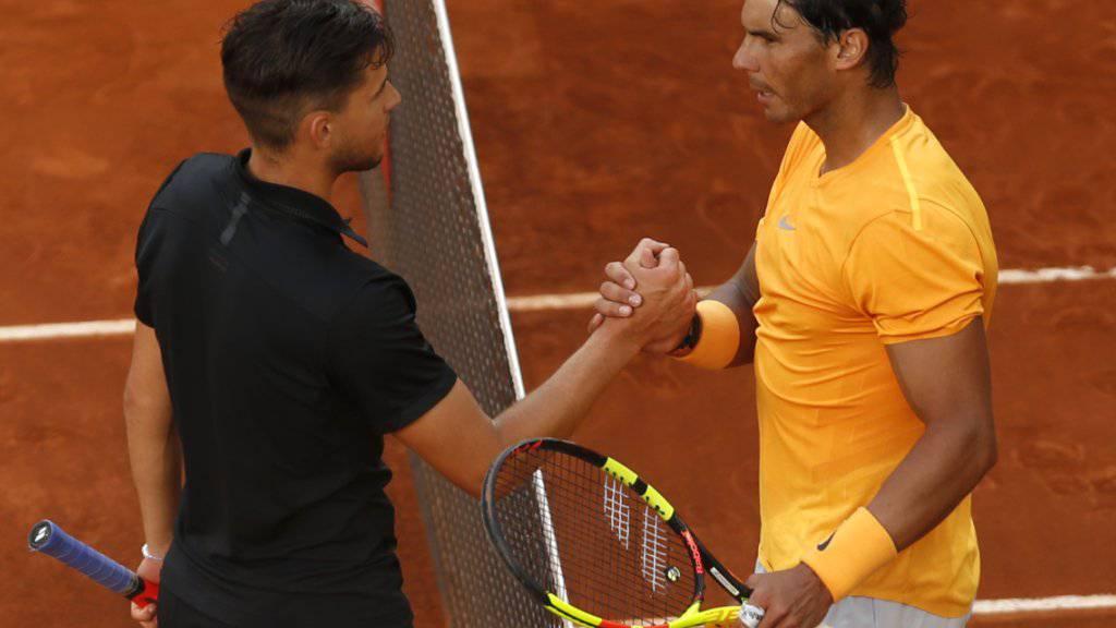 Rafael Nadal (rechts) kann in Rom nicht auf Dominic Thiem treffen: Der Österreicher scheiterte bereits in der 2. Runde