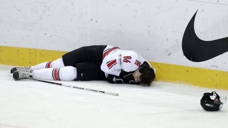 Julian Sprunger, Opfer eines Bodychecks an der WM 2009.