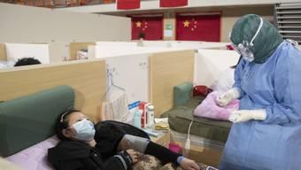 China hat am Sonntag erneut steigende Zahlen von Coronavirus-Infizierten sowie weitere Todesfälle aufgrund der Erkrankung gemeldet.