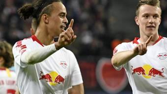 Leipzigs Yussuf Poulsen (links) traf beim Heimsieg gegen Bayer Leverkusen zwei Mal