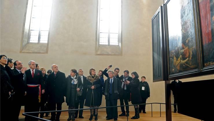 François Hollande, Gilbert Meyer, Maire von Colmar, und Bundespräsident Johann Schneider-Ammann (von links) bestaunen den Isenheimer Altar. Franck Delhomme