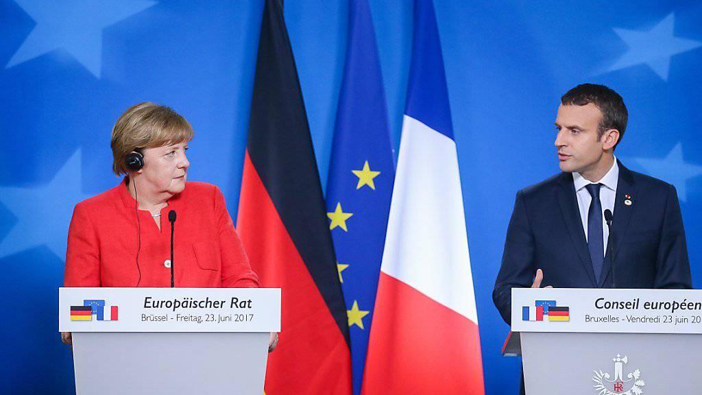 Sie haben am Freitag nach dem EU-Gipfel in Brüssel mit ihrer gemeinsamen Medienkonferenz Einigkeit demonstriert: Die deutsche Kanzlerin Angela Merkel und der französische Präsident Emmanuel Macron machten sich für einen fairen Freihandel stark.