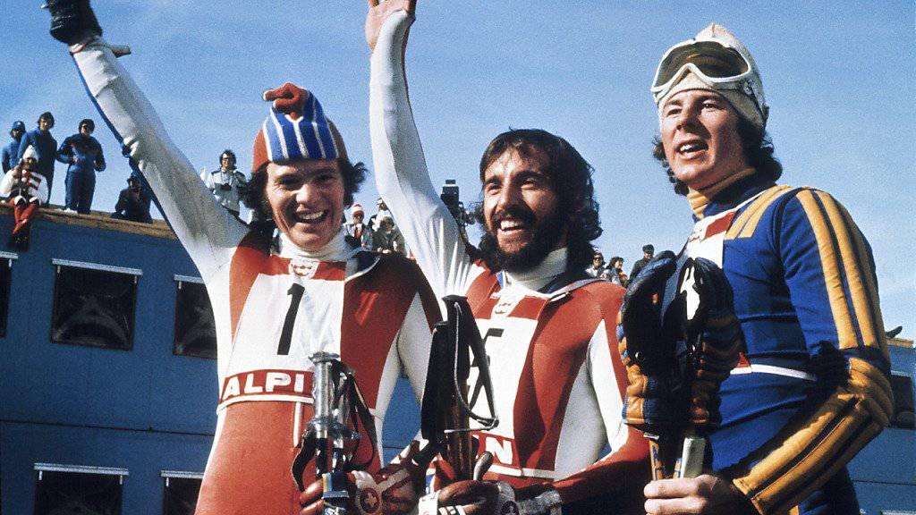 Überraschung im Olympia-Riesenslalom von Innsbruck 1976: Heini Hemmi (Mitte) und Ernst Good (links) feiern einen Doppelsieg - Ingemar Stenmark bleibt Bronze