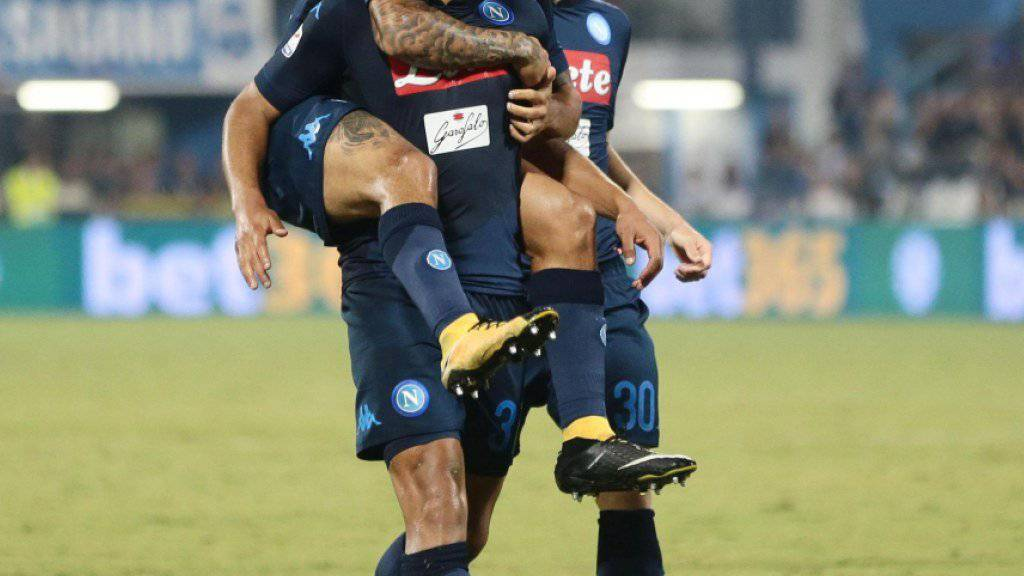 Huckepack: Napolis Verteidiger Faouzi Ghoulam zelebriert seinen Siegtreffer mit den Teamkollegen