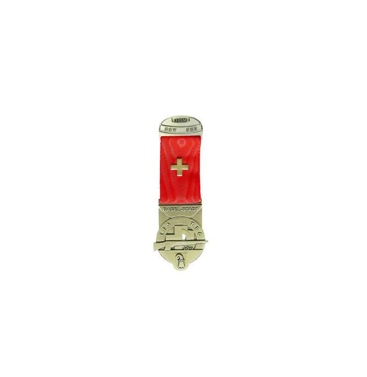 Das diesjährige Kranzabzeichen zeigt das Wappen des Kantons Basel-Stadt.
