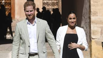 FILE - In this Monday, Feb. 25, 2019 file photo, Britain's Prince Harry and Meghan, Duchess of Sussex visit the Andalusian Gardens in Rabat, Morocco, Monday, Feb. 25, 2019. Prince Harry and Meghan, the Duchess of Sussex, may be keeping plans about their impending baby under wraps, but that hasn't stopped everyone in Britain from trying to guess what they're having - or laying a wager on the name they've chosen for their first child. (Facundo Arrizabalaga/Pool Photo via AP, File)