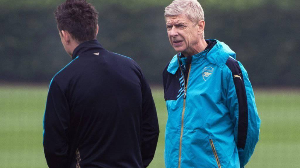 Findet Arsenals Trainer Arsene Wenger (rechts) auch für das Rückspiel in München die richtigen Worte?
