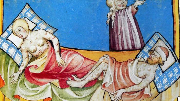 Seuchen begleiten die Menschheit seit Jahrtausenden. Moses mit zwei Opfern der Pest, einer der biblischen Plagen. Miniatur aus der Toggenburg-Bibel von 1411.