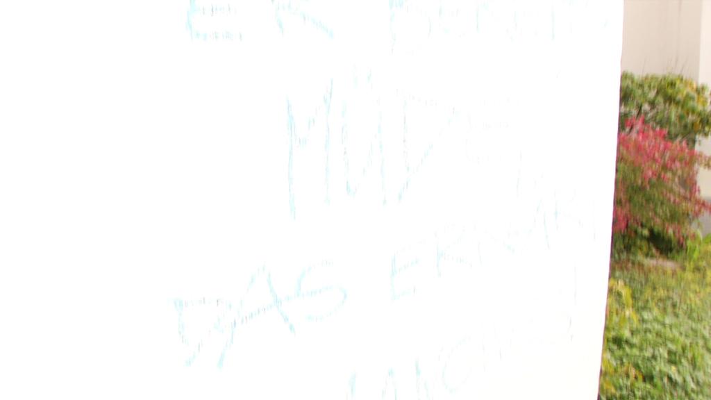 Spruch an Wand