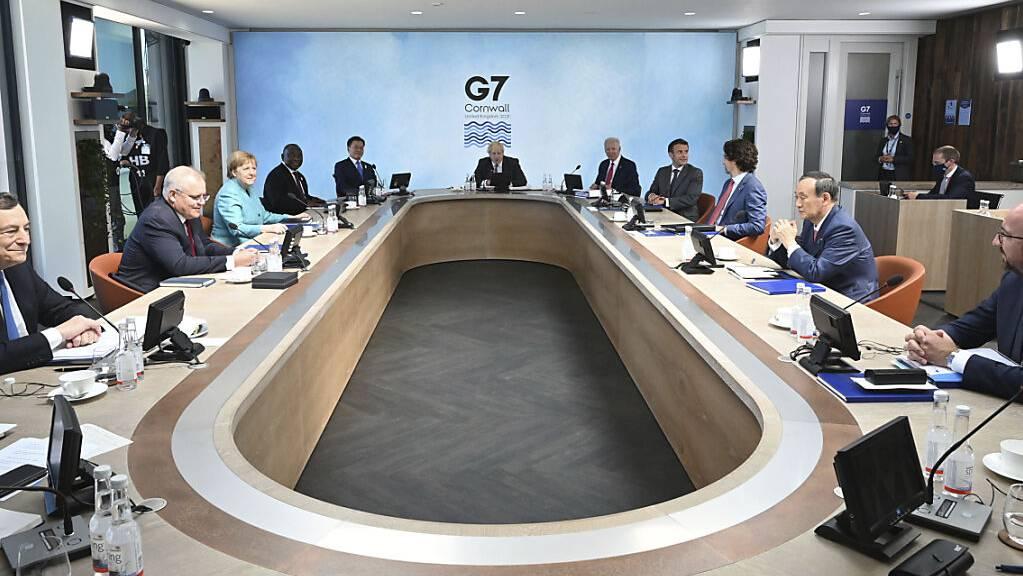 Die Staats- und Regierungschefs der großen Industrienationen. Foto: Leon Neal/Getty Pool/AP/dpa