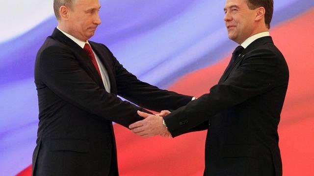 Rochade im Kreml: Wladimir Putin (l.) und Dmitri Medwedew