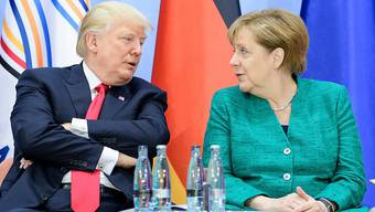 Die deutsche Kanzlerin Angela Merkel und US-Präsident Donald Trump ringen am G20-Gipfel in Hamburg um Kompromisse in verschiedenen Fragen.