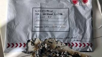 "In this handout photo provided by Sky News, a suspect package that was sent to Heathrow airport and caught fire is seen in England, Tuesday, March 5, 2019. Britain's counter-terrorism police are investigating after three suspicious packages were found in London, including one near City Airport and one near Heathrow Airport. Police said Tuesday all three write postal bags contained yellow bags thought by specialist police to be small improvised explosive devices. Police say the devices ""appear capable of igniting an initially small fire when opened."" (Sky News via AP)"