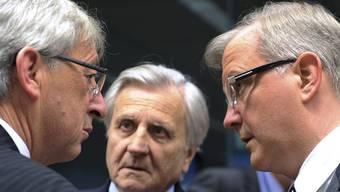 Juncker, Trichet und Rehn (von links)