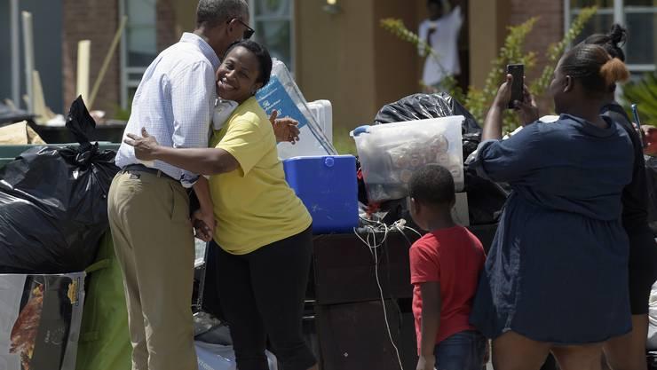 US-Präsident Barack Obama macht den Betroffenen der Überschwemmungen im US-Bundesstaat Louisiana Mut.