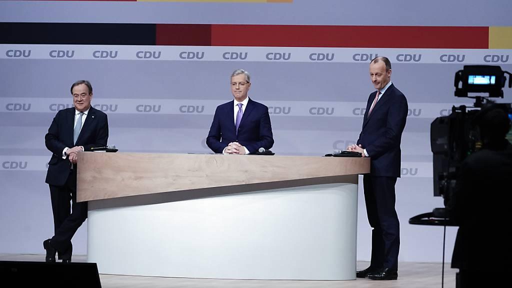 Die Kandidaten um den CDUParteivorsitz (l-r): Armin Laschet, Norbert Röttgen und Friedrich Merz. Foto: Michael Kappeler/dpa