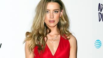 US-Schauspielerin Amber Heard zieht erneut vor Gericht: Diesmal richtet sich die Klage nicht gegen Ex-Mann Johnny Depp, sondern gegen einen Hollywood-Produzenten. (Archivbild)