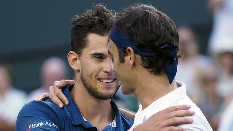 Dominic Thiem (l.) hat gegen Roger Federer (r.) drei von fünf Duellen gewonnen - einen weiteren Sieg möchte Federer nun in Madrid verhindern.