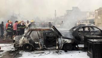 Verwüstung nach einem Autobombenanschlag im Irak (Archiv)