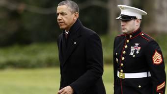 Früher als geplant ist Barack Obama (links) aus seinen Weihnachtsferien auf Hawaii nach Washington zurückgekehrt