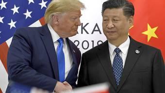 US-Präsident Donald Trump und der chinesische Präsident Xi Jinping beim letzten gemeinsamen Treffen in Japan Ende Juni. (Archivbild)