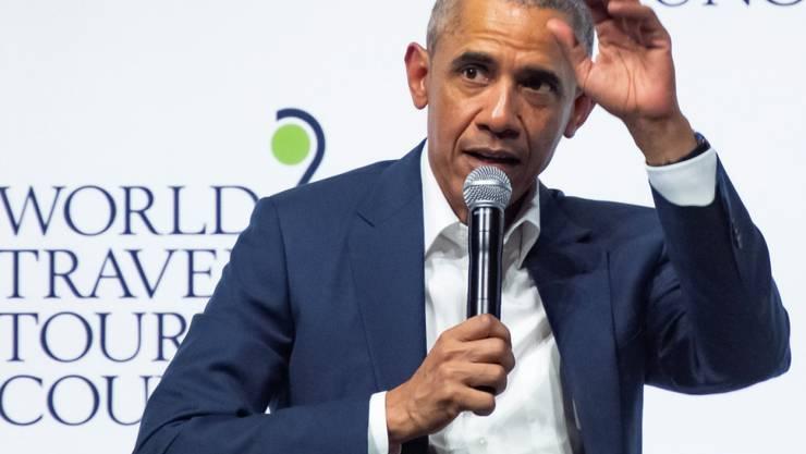 Am Mittwoch in Spanien und am Donnerstag in Deutschland: Der frühere US-Präsident Barack Obama weckt immer noch grosses Interesse. Über 14'000 Menschen haben in Köln direkt zugehört, wie er konkretere Massnahmen gegen den Klimawandel forderte. (EPA/RAUL CARO)