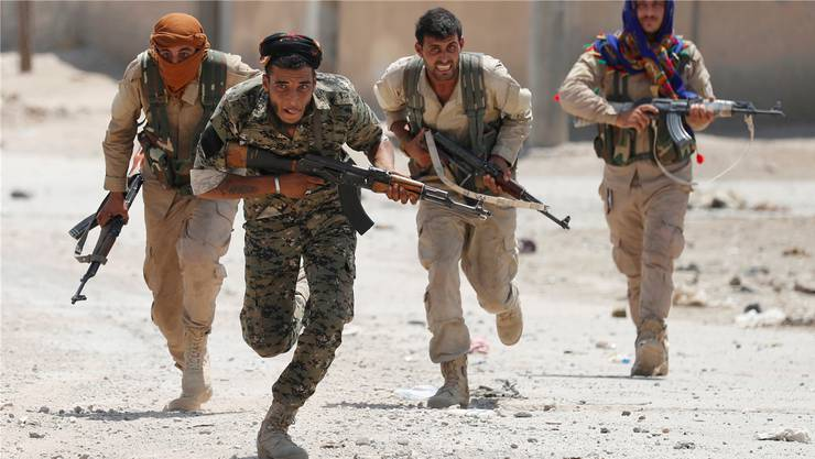 Kurdische Kämpfer in Rakka. Goran Tomasevic/REUTERS