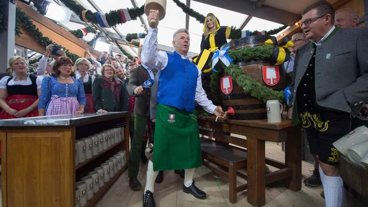 «O zapft is»: Münchens Oberbürgermeister Dieter Reiter eröffnet das Oktoberfest.
