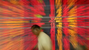 Turbulenter Handelstag für die Börsen weltweit: Konjunktursorgen in China und fallende Ölpreise liessen die Aktienmärkte abstürzen.