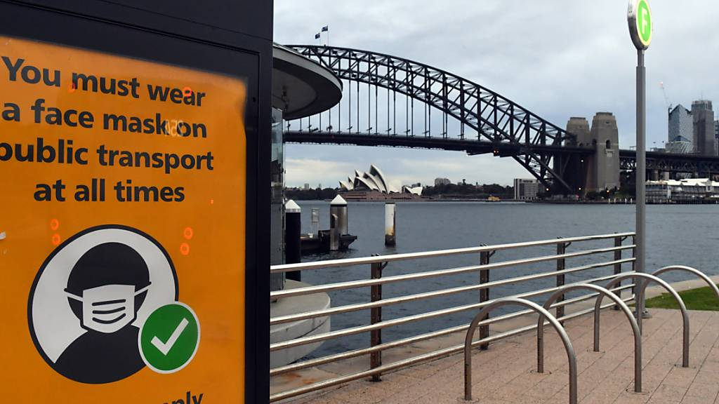A sign warning mask wearing is seen at a ferry wharf in Sydney, Wednesday, July 28, 2021. NSW recorded 177 new locally acquired cases of COVID-19 in the 24 hours to 8pm last night. (AAP Image/Mick Tsikas) NO ARCHIVING
