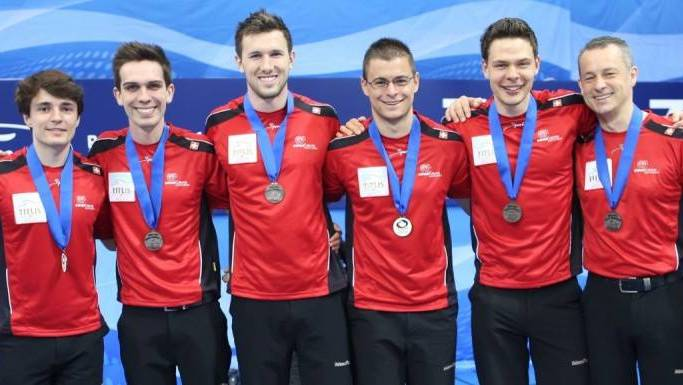 Claudio Pescia (ganz rechts) und Claudio Pätz (daneben) als Teammitglied mit der WM-Bronzemedaille.